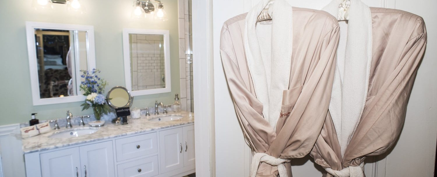 luxury robes hanging in executive suite bathroom