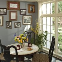 Common area dining area with hanging pictures