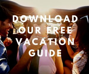 young people in a car with overlaying text saying download our free vacation guide