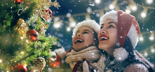 Merry Christmas And Happy Holidays Mom Daughter Decorate The Tree Outdoors For In