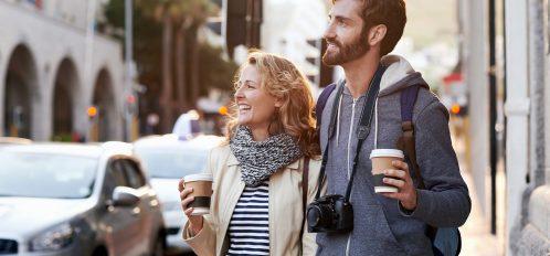 tourist couple travel with coffee ab camera walk through city having fun exploring Mississippi landmarks