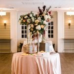 large floral centerpiece on reception table