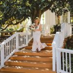 bride descending outdoor stairs