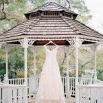 bridal gown hanging on wedding gazebo