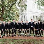 groomsmen showing off their fun socks