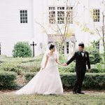 bride and groom walking outside of Fairview Inn