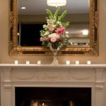 flowers and candles on fireplace mantle