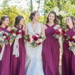 bride with bridesmaid smiling outside
