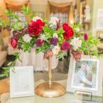 flowers with bride and groom photos