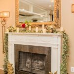 fireplace mantle with vines and candles